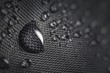 canvas print picture - Water drop on waterproof impregnated fabric of black umbrella during rain.