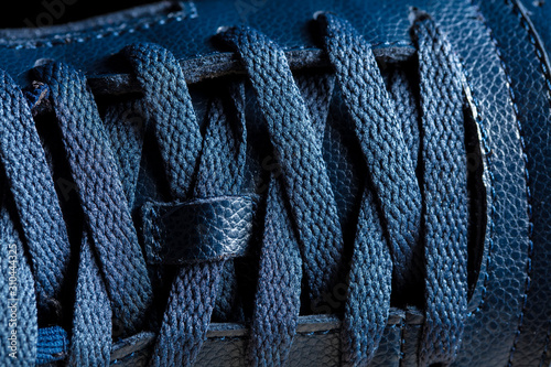 Fotomural Part of a blue boot with laces