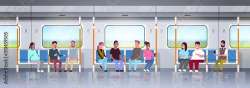 Cuadros en Lienzo  people inside subway metro train mix race passengers sitting in public transport