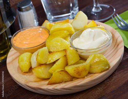 Patatas bravas with garlic mayonnaise and sauce Fotobehang