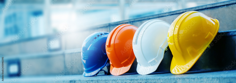 Fototapeta Multicolored Safety Construction Worker Hats. Teamwork of the construction team must have quality. Whether it is engineering, construction workers. Have a helmet to wear at work. For safety at work.