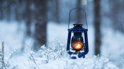 Fototapeta Mystical scene with old kerosene lamp in snow