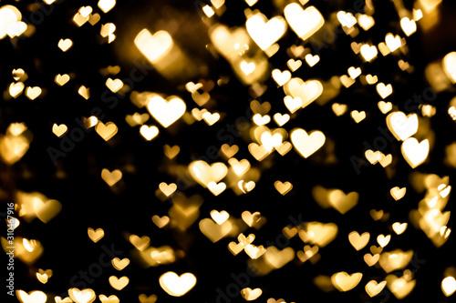 Obraz Festive overlay effect. Golden heart bokeh festive glitter background. Christmas, New Year and Valentine's day design - fototapety do salonu