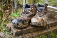 Muddy Hiking Boots In A Countr...