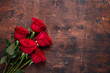 Red rose flowers bouquet on wooden background Valentine's day greeting card Copy space Top view