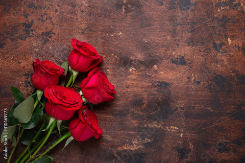 Red rose flowers bouquet on wooden background Valentine's day greeting card Copy Canvas Print