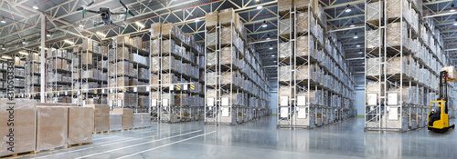 Obraz Goods monitoring by Drone in a Huge distribution warehouse with high shelves - fototapety do salonu