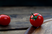 Cherry Tomatos On Wooden Cutti...