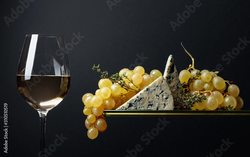 Glass of white wine with snacks Canvas-taulu