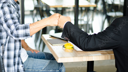 Fototapety, obrazy: Business partners Giving Fist Bump  about starting  Construction project