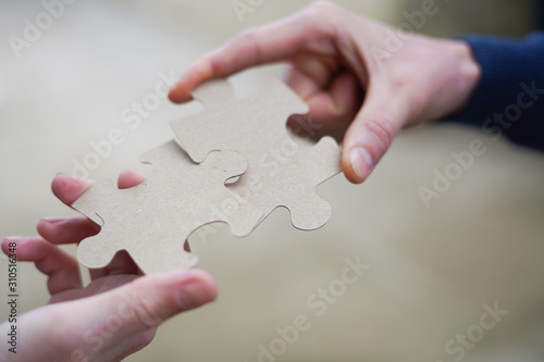 Fotografia Cooperation puzzle partnership teamwork in business team group company