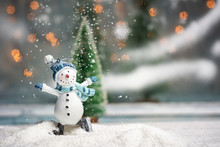 Toy Snowman With Festive Illuminated Christmas Holiday Background