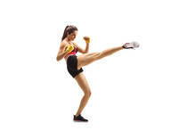 Young Fit Woman Kicking With A Leg