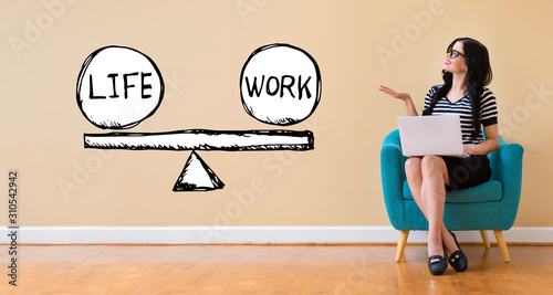 Life and work balance with young woman using a laptop computer - 310542942