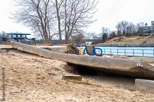 Canvas Print broken sidewalk due to beach erosion damage in Michigan