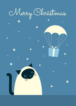 "Greeting Card ""Merry Christmas"". Vector Retro Styled Illustration Of S Siamese Cat Sitting And Watching A Gift Landing With A Parachute. Blue-gray Background, Starry Sky. Vertical Format."
