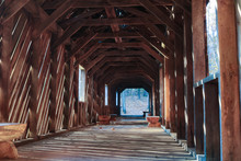 Inside A Covered Wooden Bridge
