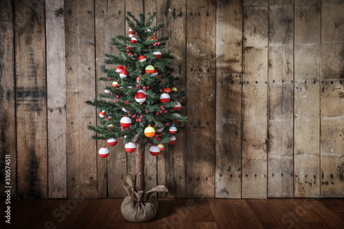 Christmas tree hung with brightly colored fishing bobber floats Fototapet