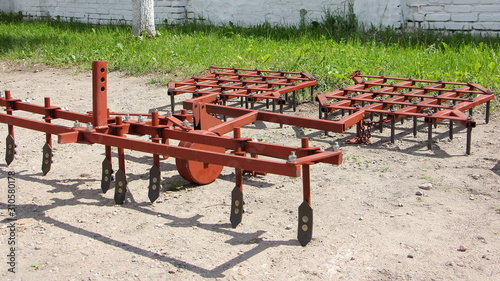 Fototapeta New modern external harrow for two wheel walk-behind mini tractor, optional farm