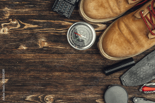 Cuadros en Lienzo  Hiking boots, compass and knife. Hiking outdoor equipment