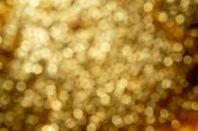 Gold Bokeh On Black Background