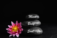 Stones With Words Mind, Body, Soul And Lotus Flower On Black Background. Zen Lifestyle