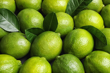 Fresh ripe juicy limes as background, closeup