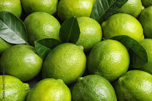 Canvas-taulu Fresh ripe juicy limes as background, closeup