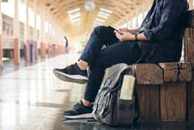Young Man Traveler Sitting Wit...