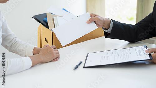 Obraz Sad dismissed businessman sitting outside the office after losing his job - fototapety do salonu