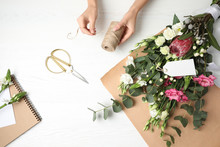 Florist Making Beautiful Bouqu...