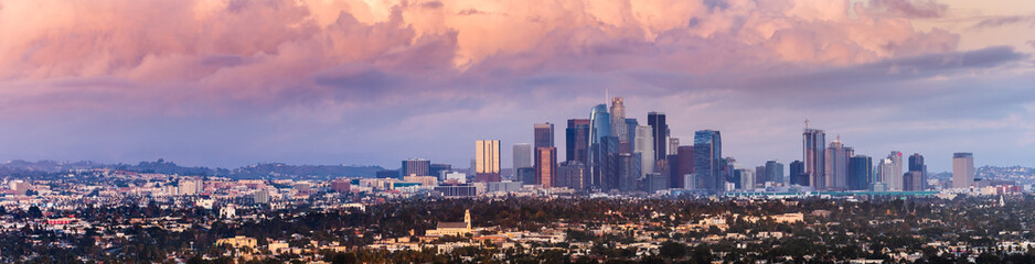 Panoramic view of downtown Los Angeles skyline at sunset, colorful storm clou...