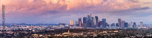 Panoramic view of downtown Los Angeles skyline at sunset, colorful storm clouds covering the sky; California - 310597787