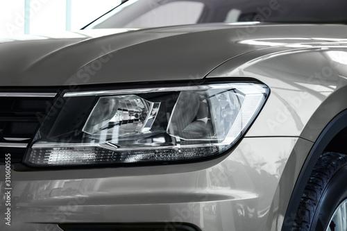 Obraz New luxury car in modern auto dealership, closeup - fototapety do salonu