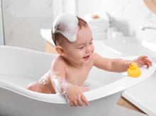 Cute Little Baby In Bathtub At Home