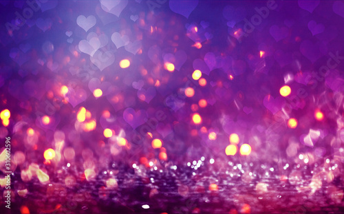 Obraz Hearts on a sparkling shiny background. Red abstract background. Blurry bokeh, neon light. - fototapety do salonu