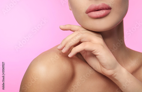 Woman with matte lipstick on pink background, closeup - 310611127