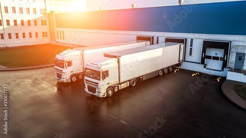 Obraz na płótnie trucks are loaded in a modern logistics center..
