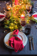 Christmas festive table setting with fir-tree branch and glasses