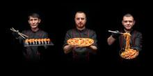 Three Male Cooks In Black Tuni...