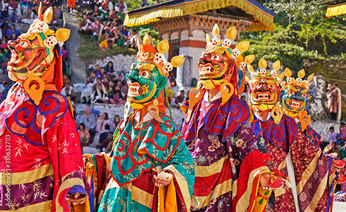 Performers dancers wearing masks in festival in Mongar, Bhutan Canvas Print