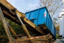 Unloading Empty Dumpster Resid...