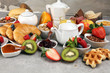 Leinwanddruck Bild - Breakfast served with coffee, orange juice, croissants, cereals and fruits. Balanced diet. Continental breakfast with granola and fruits