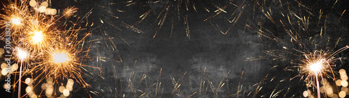 Fototapeta Silvester background banner panorama long- firework on rustic dark black grey stone concrete texture, with space for text obraz na płótnie