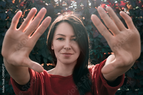 Fotomural Young beautiful woman enchantment. Stay away. Stop. Distance.