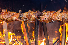 Roasting Chicken On An Open Fire In The Market.