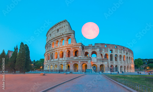 Fényképezés Colloseum with amazing pink full moon , Rome, ITALY Elements of this image furn