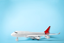 Toy Plane On Blue Background, Space For Text. Logistics And Wholesale Concept