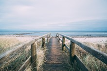 Beautiful Scenery Of A Wooden Pathway Leading To The Beach For A Relaxing Day