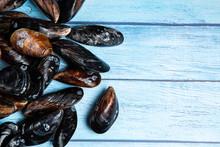 Fresh Raw Mussels On Blue Wood...